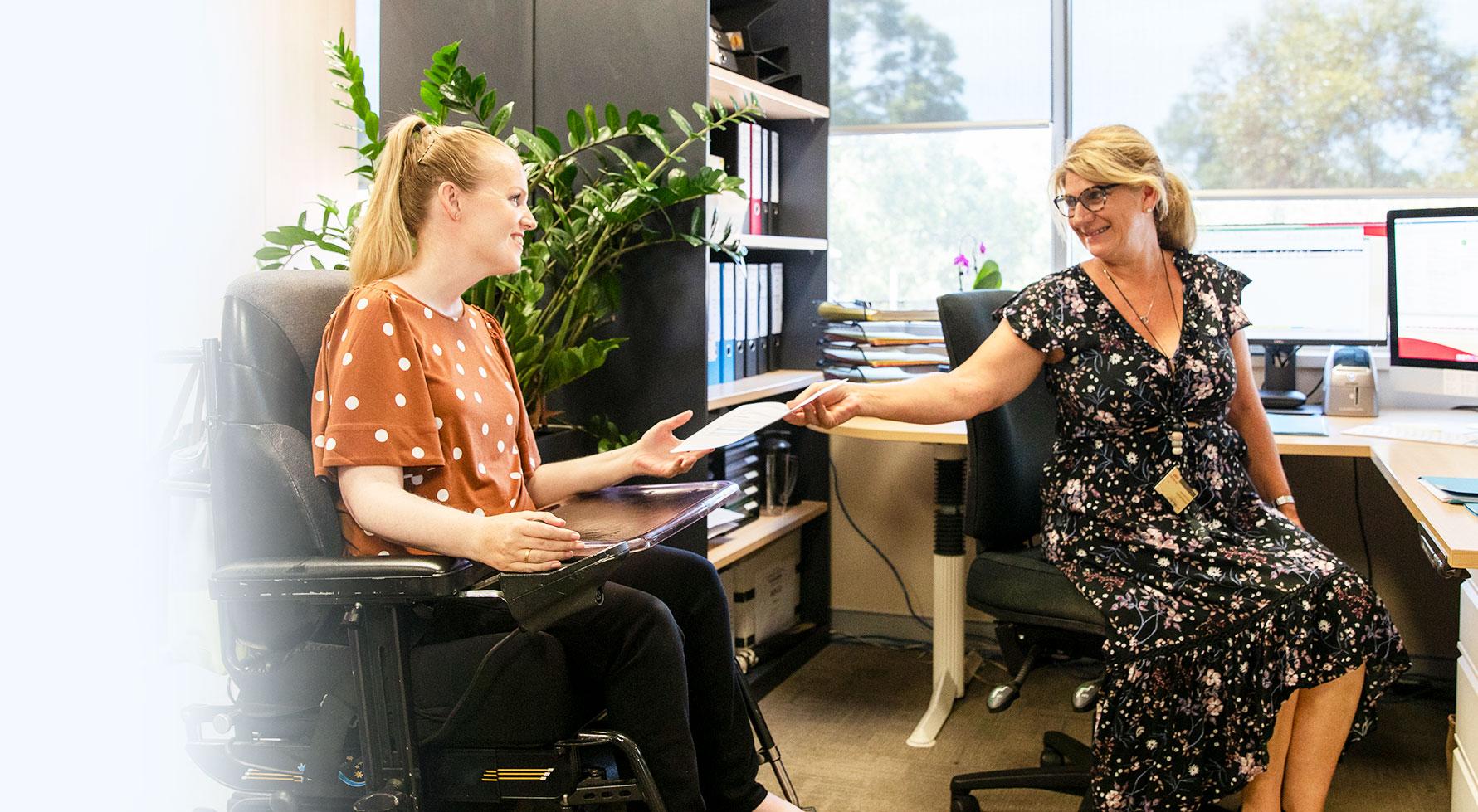 Woman in a wheechair working in an office