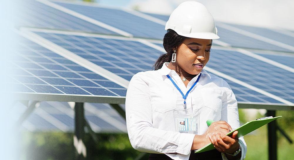 Woman working on a solar energy farm